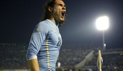 In this June 4, 2014, photo, Uruguay's Edinson Cavani celebrates after scoring against  Slovenia during a friendly soccer match in Montevideo, Uruguay. (AP Photo/Matilde Campodonico)