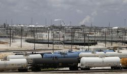 **FILE** Railroad tanker cars line alongside a Dow Chemicals plant in Freeport, Texas, on May 22, 2014. (Associated Press)
