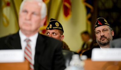 American Legion Headquarters Executive Director Peter Gaytan, center, American Legion National Legislative Commission Deputy Director Ian DePlanque, right, listens in the audience as Acting Veterans Affairs Inspector General Richard Griffin, left, testifies at a House Veterans' Affairs Committee hearing on Capitol Hill, Washington, D.C., Monday, June 9, 2014. (Andrew Harnik/The Washington Times)