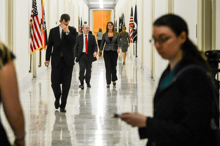 Veteran Affairs Undersecretary for Health for Administrative Operations Assistant Deputy Philip Matkovsky, left, walks back to a House Veterans' Affairs Committee hearing during a break in his testimony on Capitol Hill, Washington, D.C., Monday, June 9, 2014. (Andrew Harnik/The Washington Times)
