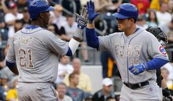 Chicago Cubs' Anthony Rizzo, right, is greeted by teammate Junior Lake (21) who was on base for his two-run home run off Pittsburgh Pirates starting pitcher Francisco Liriano during the first  inning of a baseball game in Pittsburgh Tuesday, June 10, 2014. (AP Photo/Gene J. Puskar)
