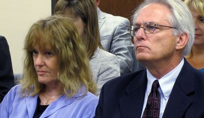 FILE - In this June 22, 2013 file photo Dr. Ann Kristin Neuhaus, left, sits with attorney Bob Eye in Topeka, Kan., as the Kansas State Board of Healing Arts revokes her license over referrals of patients for late-term abortions. The Kansas Court of Appeals on Tuesday, June 10, 2014 forced the board to reconsider its decision to revoke Neuhaus' license for referring young patients to the late Dr. George Tiller. (AP Photo/John Hanna, File)