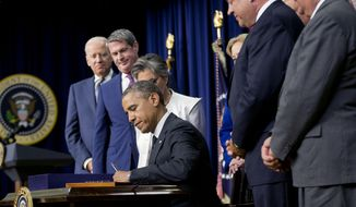 President Barack Obama signs H.R. 3080, the Water Resources Reform, Tuesday, June 10, 2014, in the South Court Auditorium in the Eisenhower Executive Office Building on the White House complex in Washington, Tuesday, June 10, 2014, in Washington. From left are, Vice President Joe Biden, Sen. David Vitter, R-La., and Sen. Barbara Boxer, D-Calif.  (AP Photo/Pablo Martinez Monsivais)