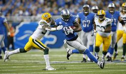 FILE - In this Nov. 28, 2013, file photo, Detroit Lions wide receiver Calvin Johnson (81) is defended by Green Bay Packers cornerback Sam Shields during an NFL football game in Detroit. Signing a four-year, $39 million deal with a $12.5 million signing bonus can be a life-changing event, especially for the fifth-year undrafted cornerback Shields who didn't move to defense until his last year in college. (AP Photo/Rick Osentoski, File)
