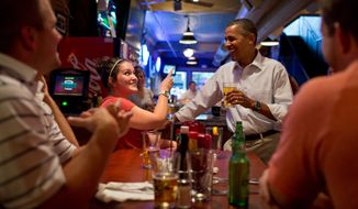 President Barack Obama has a beer with patrons at the Pump Haus Pub and Grill in Waterloo, Iowa, Aug. 14, 2012. (Official White House Photo by Pete Souza)