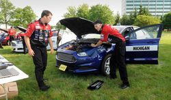 "Mike Smith, left, and Alan LaBarge, from Oxford High School, compete in the ""Get Your Motor Running"" 65th Annual National Student Auto Skills Competition at Ford World Headquarters in Dearborn, Mich. on Tuesday, June 10, 2014. One hundred of the top automotive high school students from all fifty states will compete for the national title and millions of dollars in scholarships and prizes in the event hosted by Ford Motor Company and AAA. (AP Photo/The Detroit News, Charles V. Tines) DETROIT FREE PRESS OUT; HUFFINGTON POST OUT"