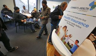 **FILE** Walk-in clients at Connect For Health Colorado, the state's health care exchange in Denver, wait for their names to be called to sign up for insurance on on March. 31, 2014, the last day before fines are imposed. Colorado has already exceeded baseline federal goals for enrollment. (Associated Press)