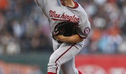 Washington Nationals pitcher Stephen Strasburg winds up during the first inning of a baseball game against the San Francisco Giants, Monday, June 9, 2014, in San Francisco, Calif. (AP Photo/Beck Diefenbach)