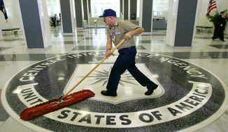 "FILE - In this 2005 file photo, a workman slides a dustmop over the floor at the Central Intelligence Agency headquarters in Langley, Va., near Washington. Fifteen CIA employees were found to have committed sexual, racial or other types of harassment last year, including a supervisor who was removed from the job after engaging in ""bullying, hostile behavior,"" and an operative who was sent home from an overseas post for inappropriately touching female colleagues, according to an internal CIA document obtained by The Associated Press.  (AP Photo/J. Scott Applewhite)"