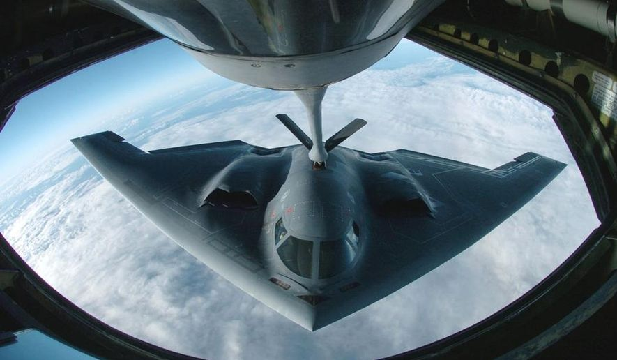 A B-2 Spirit multi-role bomber conducts air refueling operations with a KC-135 Stratotanker over the Pacific on April 4, 2005. (Image: Department of Defense)