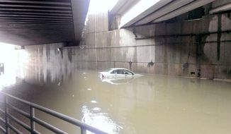 Two vehicles were stranded in high water on Paint Branch Parkway under a Metro bridge. The motorists were rescued. (Photo courtesy Mark Brady, Prince George's County Fire/EMS Department)