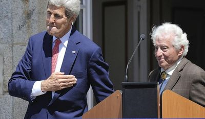 U.S. Secretary of State John Kerry and U.S. WWII photographer Tony Vaccaro, right, attend the inauguration of the Tony Vaccaro Square, in front of the Saint-Briac-sur-Mer city hall, western France, Saturday, June 7, 2014. (AP Photo/Jean Sebastien Evrard, Pool)