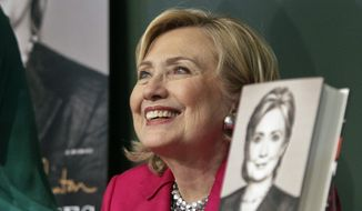 """** FILE ** HiIlary Rodham Clinton listens before signing a copy of her book, """"Hard Choices"""" on Tuesday, June 10, 2014, at Barnes and Noble bookstore in New York. (AP Photo/Bebeto Matthews)"""