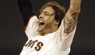San Francisco Giants' Michael Morse celebrates after making the game winning hit in the ninth inning of a baseball game against the New York Mets Saturday, June 7, 2014, in San Francisco. (AP Photo/Ben Margot)