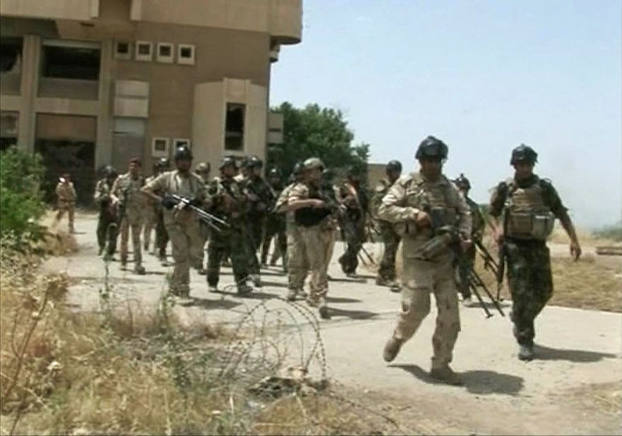 In this Monday, June 9, 2014, image taken from video obtained from the Iraqi military, which has been authenticated based on its contents and other AP reporting, military soldiers prepare to take their positions during clashes with militants in the northern city of Mosul, Iraq. (AP Photo/Iraqi Military via AP video)