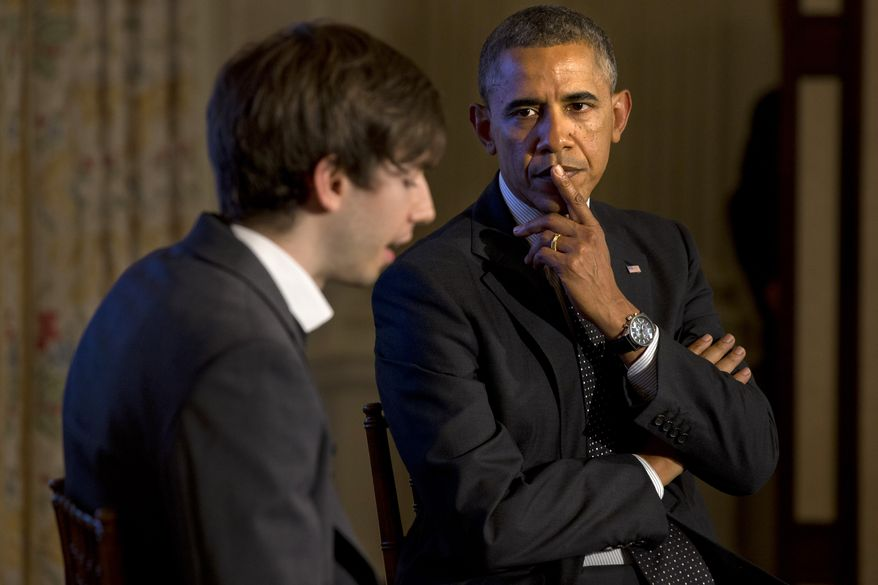 President Barack Obama listens to a question submitted on Tumblr, read by Tumblr Founder and CEO David Karp, left, during a Tumblr forum, Tuesday, June 10, 2014, in the State Dining Room of the White House in Washington. (AP Photo/Jacquelyn Martin)