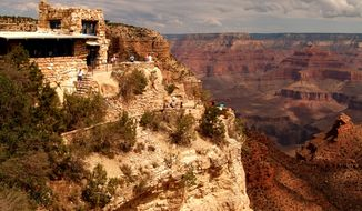 This photo provided by Xanterra South Rim shows the exterior of Lookout Studio, a historic century-old structure near Grand Canyon Village on the South Rim of the Grand Canyon in Arizona. Lookout Studio is one of a number of attractions available for sightseeing at the South Rim. The Grand Canyon Railway carries 225,000 visitors a year to the South Rim from Williams, Ariz.  (AP Photo/Xanterra South Rim, L.L.C.)