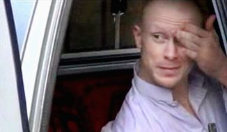 ** FILE ** In this file image taken from video obtained from Voice Of Jihad Website, which has been authenticated based on its contents and other AP reporting, Sgt. Bowe Bergdahl, sits in a vehicle guarded by the Taliban in eastern Afghanistan. (AP Photo/Voice Of Jihad Website via AP video, File)