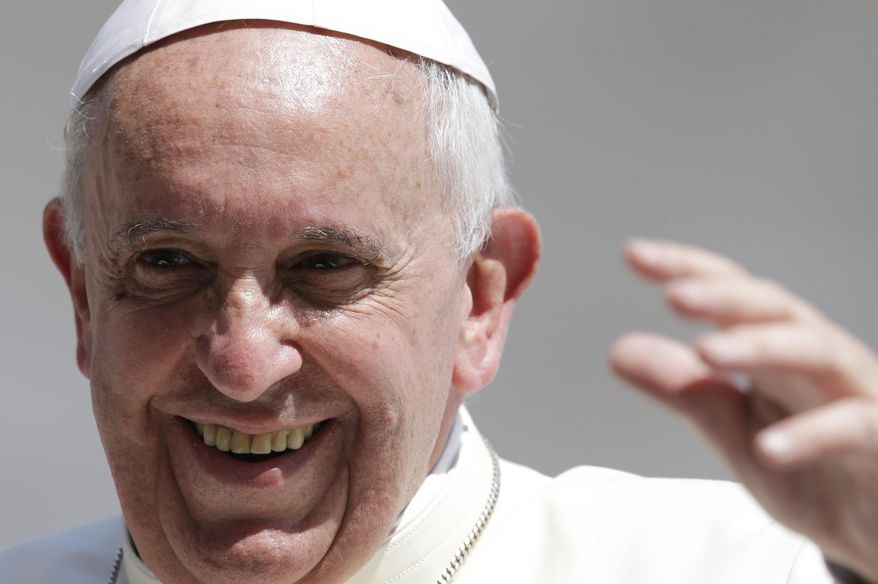 Pope Francis smiles as he waves to faithful at the end of his weekly general audience in St. Peter's Square at the Vatican, Wednesday, June 11, 2014. (AP Photo/Gregorio Borgia)