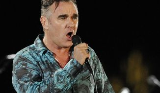 In this April 17, 2009, file photo, Morrissey performs during the first day of the Coachella Valley Music & Arts Festival in Indio, Calif. (AP Photo/Chris Pizzello, file)