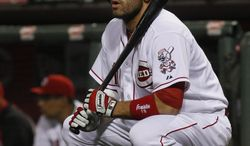 Cincinnati Reds Joey Votto gets ready to bat in the first inning of the baseball game between the Los Angeles Dodgers and the Cincinnati Reds in Cincinnati Tuesday June 10, 2014. (AP Photo/Tom Uhlman)