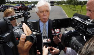 Sen. Thad Cochran, R-Miss., speaks with reporters prior to visiting Siemens' Energy Sector in Richland, Miss., Wednesday, June 11, 2014, during a campaign swing through central Mississippi. Cochran is in a runoff race for the GOP nomination for the Senate with state Sen. Chris McDaniel. (AP Photo/Rogelio V. Solis)