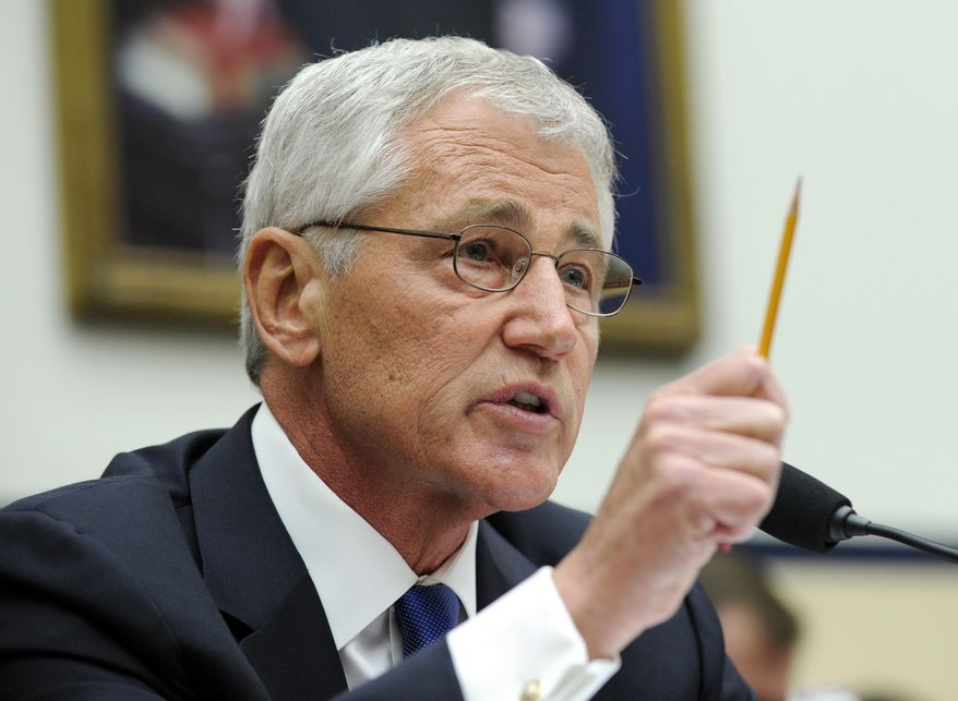 Defense Secretary Chuck Hagel testifies on Capitol Hill in Washington, Wednesday, June 11, 2014, before the House Armed Services Committee. Hagel faced angry lawmakers becoming the first Obama administration official to testify publicly about the controversial prisoner swap with the Taliban. (AP Photo/Susan Walsh)