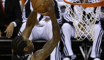 San Antonio Spurs forward Kawhi Leonard (2) goes to the basket against the Miami Heat in the first half in Game 3 of the NBA basketball finals, Tuesday, June10, 2014, in Miami.  (AP Photo/Lynne Sladky)