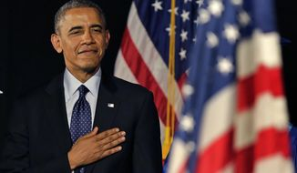 President Obama stands for the National Anthem during the graduation ceremony for Worcester Technical High School, Wednesday, June 11, 2014, in Worcester, Mass. Afterward he will attend a democratic fundraiser in Massachusetts, before returning to Washington. (AP Photo/Charles Krupa)