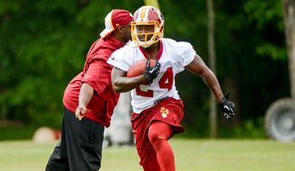 Washington Redskins Silas Redd (24) runs a drill during organized team activities at Redskins Park, Ashburn, Va., Wednesday, June 11, 2014. (Andrew Harnik/The Washington Times)