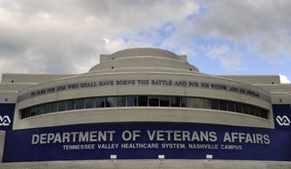 The Department of Veterans Affairs hospital stands Wednesday, June 11, 2014, in Nashville, Tenn. The director of the Tennessee Valley Healthcare System said Wednesday that it will soon receive as much as $15 million to address an audit showing long wait times for veterans. Juan Morales told reporters that the money will help pay for additional physician-support staff and fees that may be incurred if a veteran has to be sent to an outside provider. (AP Photo/The Tennessean, George Walker IV)