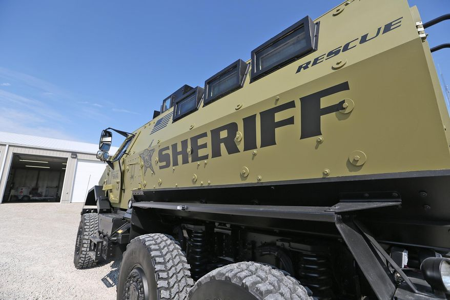 A new vehicle in the Johnson County law enforcement arsenal is this military surplus armored personnel carrier, seen May 29, 2014, in Franklin, Ind. As a military vehicle, it was called a mine-resistant ambush-protected vehicle, or MRAP. (AP Photo/The Indianapolis Star, Kelly Wilkinson) NO SALES