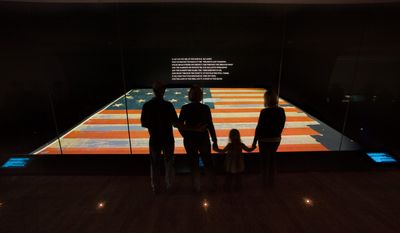 The nearly 200-year-old 30-by-34-foot Star-Spangled Banner is displayed in a low-oxygen, environmentally controlled chamber in the National Museum of American History. (Smithsonian Institution via Associated Press)