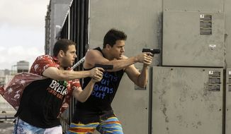 "Jonah Hill, left, and Channing Tatum return as a comic pair of undercover cops, Schmidt and Jenko, posing as college students in ""22 Jump Street."" (Sony Pictures via Associated Press)"