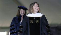 FILE - In this Monday, May 19, 2014, file photo, Jill Abramson, former executive editor of The New York Times, receives an honorary Doctor of Humane Letters degree during the commencement ceremony at Wake Forest University in Winston-Salem, N.C. Abramson is joining Harvard University as a visiting lecturer this coming school year, the university announced Thursday, June 12, 2014. (AP Photo/Nell Redmond, File)