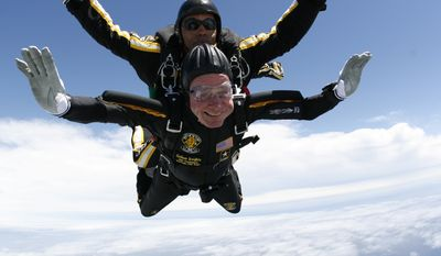 Former President George H. W. Bush rides tandem with Sgt. Michael Elliott of the Army Golden Knights parachute team as he celebrates his 85th birthday with a parachute jump, Friday, June 12, 2009, over Kennebunkport, Maine. (AP Photo/Army Golden Knights, SSG Joe Abeln)