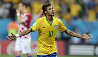 Brazil's Neymar celebrates his second goal on a penalty kick during the group A World Cup soccer match between Brazil and Croatia, the opening game of the tournament, in the Itaquerao Stadium in Sao Paulo, Brazil, Thursday, June 12, 2014.  (AP Photo/Ivan Sekretarev)