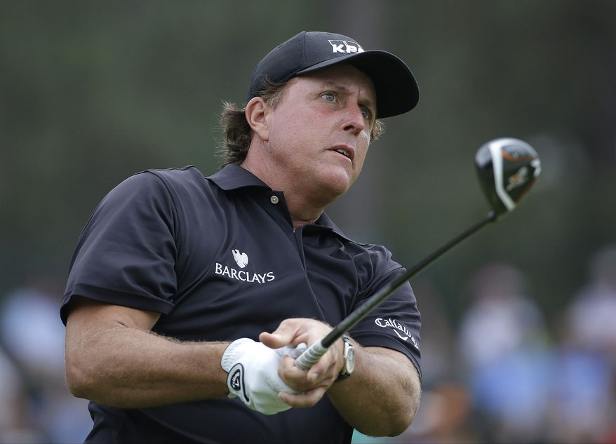 Phil Mickelson watches his tee shot on the 13th hole during the first round of the U.S. Open golf tournament in Pinehurst, N.C., Thursday, June 12, 2014. (AP Photo/David Goldman)