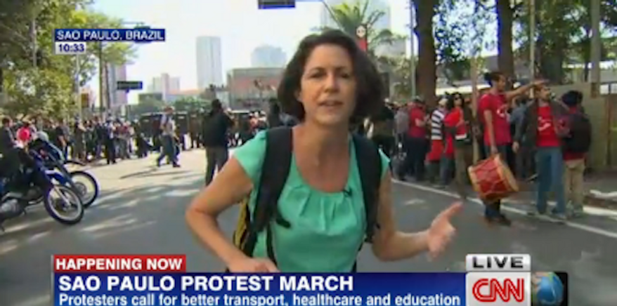 """CNN correspondent Shasta Darlington (pictured) suffered """"a minor cut on her arm"""" and producer Barbara Arvanitidis """"was hit on her wrist"""" reportedly by a tear gas canister fired by police during a protest in Sao Paulo. (CNN)"""