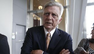 Arkansas Gov. Mike Beebe talks to reporters after speakiing to members of the Delta Grassroots Caucus in Little Rock, Ark., Thursday, June 12, 2014. Beebe said he remains cautiously optimistic that Arkansas will keep its compromise Medicaid expansion alive next year despite the defeat of a legislator who helped design the program. (AP Photo/Danny Johnston)