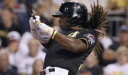 Pittsburgh Pirates' Andrew McCutchen drives in two runs with a double off Chicago Cubs starting pitcher Jeff Samardzija during the fifth inning of a baseball game in Pittsburgh, Thursday, June 12, 2014. McCutchen was out at third while trying to stretch the double into a triple. (AP Photo/Gene J. Puskar)