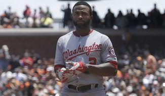 Washington Nationals' Denard Span reacts after striking out against San Francisco Giants pitcher Tim Hudson during the third inning of a baseball game in San Francisco, Thursday, June 12, 2014. The Giants won 7-1. (AP Photo/Jeff Chiu)