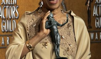 "FILE - In this Jan. 27, 2008 file photo, Ruby Dee poses with the award for outstanding performance by a female actor in a supporting role for her work in ""American Gangster"" at the 14th Annual Screen Actors Guild Awards, in Los Angeles. Dee, an acclaimed actor and civil rights activist whose versatile career spanned stage, radio television and film, has died at age 91, according to her daughter. Nora Davis Day told The Associated Press on Thursday, June 12, 2014, that her mother died at home at New Rochelle, New York, on Wednesday night.   (AP Photo/Reed Saxon, file)"