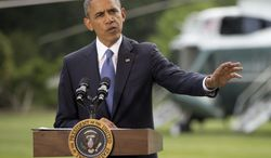 President Barack Obama talks about his administration's response to a growing insurgency foothold in Iraq, Friday, June 13, 2014, on the South Lawn of the White House in Washington, prior to boarding the Marine One Helicopter for Andrews Air Force Base, Md., then onto North Dakota and California. (AP Photo/Pablo Martinez Monsivais)
