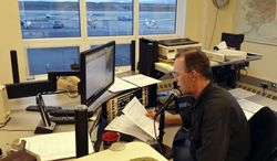 In this June 9, 2014 photo, National Weather Service meteorological technician Robert Murders reads the weather at the weather service office in Nome, Alaska. The Nome and Kodiak offices are among the last two in the nation to still use human voices for weather forecasts, but that will soon change. Both officers are switching to computerized voices that nationally go by the names of Tom, Donna and, in some parts of the country, Spanish-speaking Javier. It's an idea first hatched in the mid-1990s as part of a move to modernize the weather service, an agency of the National Oceanic and Atmospheric Administration. (AP Photo/KNOM, Rolland Trowbridge)