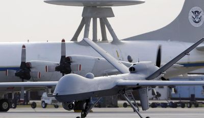*FILE** A Predator B unmanned aircraft taxis at the Naval Air Station in Corpus Christi, Texas, on Nov. 8, 2011. (Associated Press)