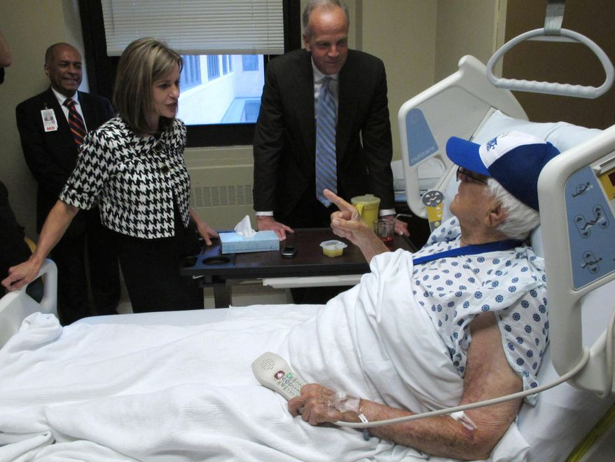 ** FILE ** Bob Brown, an 87-year-old World War II veteran from Perry Kan., speaks with U.S. Rep. Lynn Jenkins, left, and U.S. Sen. Jerry Moran, right, during their visit to the Colmery-O'Neil Veterans Affairs Medical Center, Friday, June 13, 2014, in Topeka, Kan. Some Kansas veterans can't get medical appointments at U.S. Veterans Affairs facilities and are having scheduled checkups canceled as the dates approach, the two members of the state's congressional delegation said after touring the in Topeka VA medical center.  (AP Photo/John Hanna)