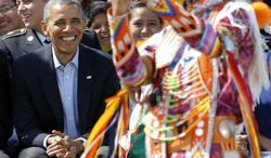 A young male Native American dancer creates a selfie with President Barack Obama on the Standing Rock Indian Reservation Friday, June 13, 2014, photo in Cannon Ball, N.D. President Obama is making his first presidential visit to Indian Country for a look at two sides of Native American life, a celebration of colorful cultural traditions on the powwow grounds and a view of the often bleak modern-day conditions on tribal lands. (AP Photo/Charles Rex Arbogast)