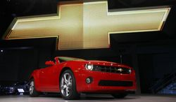 """** FILE ** In this Wednesday, Nov. 17, 2010, file photo, the 2011 Chevrolet Camaro convertible debuts at the Los Angeles Auto Show. General Motors is recalling nearly 512,000 Chevrolet Camaro muscle cars from the 2010 to 2014 model years. A driver's knee can bump the key and knock the switch out of the """"run"""" position, causing an engine stall. (AP Photo/Reed Saxon, File)"""