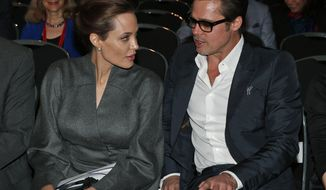 US actress Angelina Jolie, left, Special Envoy of the United Nations High Commissioner for Refugees, and her partner US actor Brad Pitt, right, sit during the 'End Sexual Violence in Conflict' summit in London, Friday, June 13, 2014. The Summit welcomed governments from over 100 countries, over 900 experts, NGOs, Faith leaders, and representatives from international organisations across the world. (AP Photo/Lefteris Pitarakis)